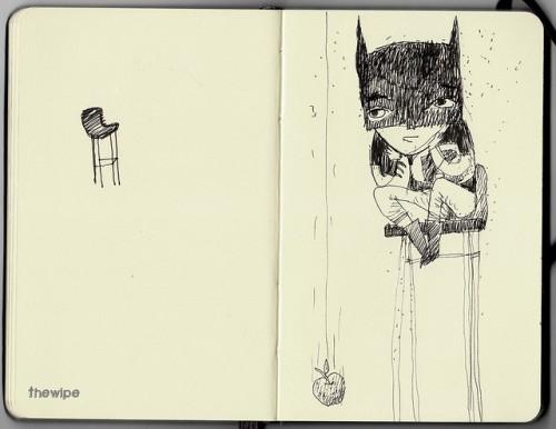 Batman kid on a high chair